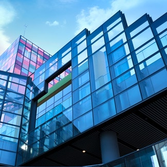 view of glass building from street level